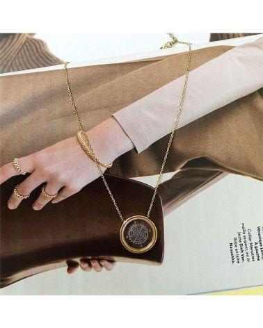 Collier doré pendentif boussole